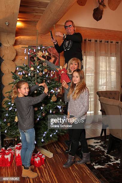 Carmen Geiss Robert Geiss and their daughters Davina Shakira and Shania Tyra pose during a photo shooting in their house on December 13 2014 in...
