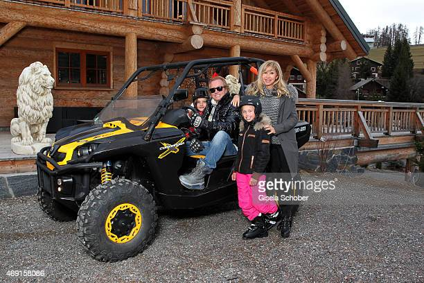 Carmen Geiss Robert Geiss and their daughters Davina Shakira and Shania Tyra pose during a photo shooting outside their house on December 13 2014 in...
