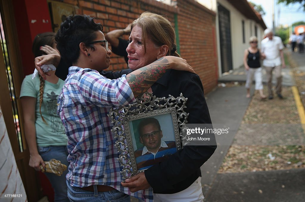 Carmen Gonzales hugs a student protester following a mass for her son Jimmy Vargas, 34, on March 7, 2014 in San Cristobal, Venezuela. Vargas died in a clash between students and the Venezuelan national guard on February 24 during an anti-government protest.