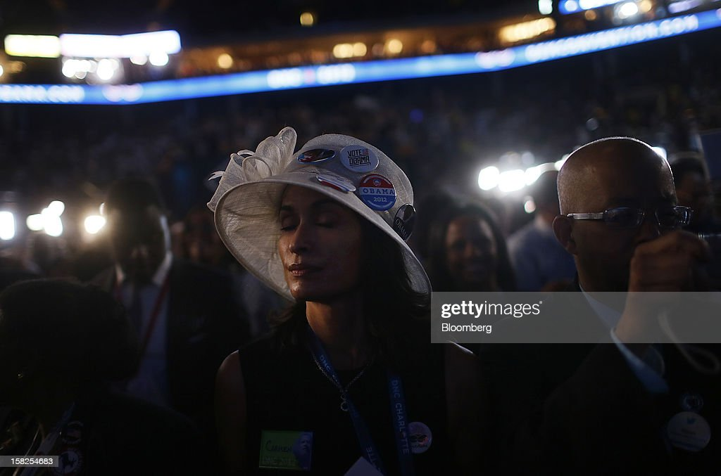Carmen H. Lonstein, a delegate from Illinois, closes her eyes while listening to former U.S. President Bill Clinton, unseen, speak during day two of the Democratic National Convention (DNC) in Charlotte, North Carolina, U.S., on Wednesday, Sept. 5, 2012. Democratic officials have moved President Barack Obama's nomination acceptance speech tomorrow night to the Time Warner Cable Arena from the larger, outdoor Bank of America Stadium because of the possibility of severe weather. Photographer: Victor J. Blue/Bloomberg via Getty Images