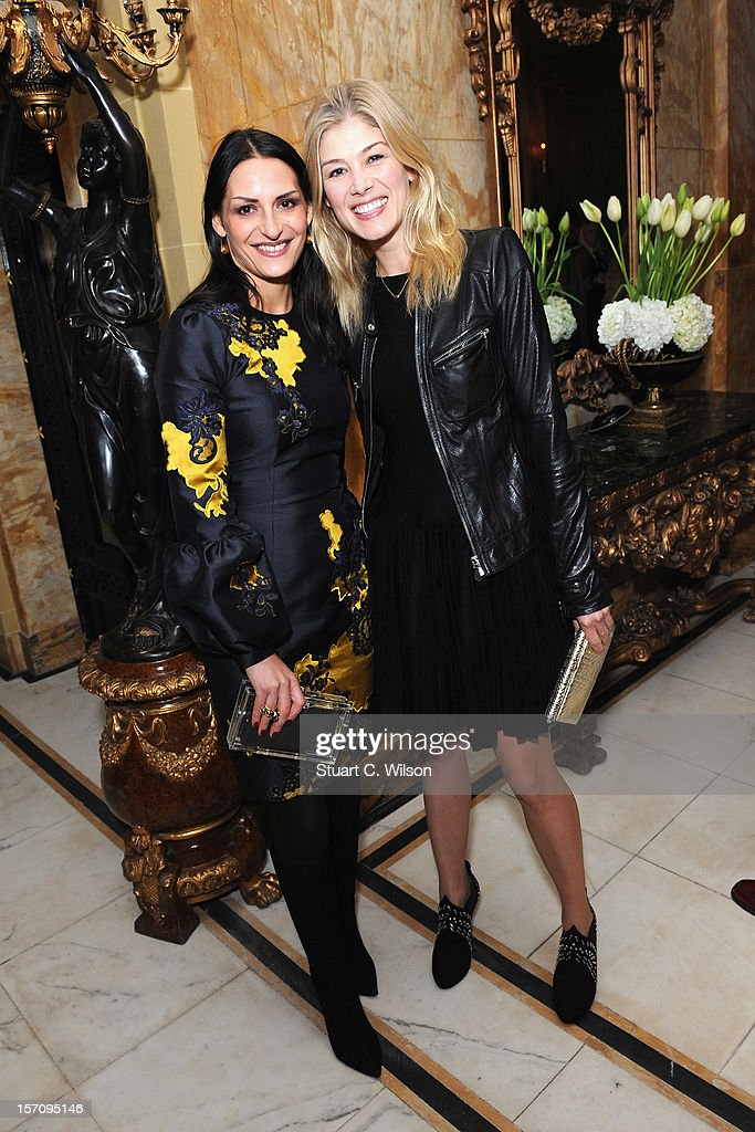 Carmen Haid and <a gi-track='captionPersonalityLinkClicked' href=/galleries/search?phrase=Rosamund+Pike&family=editorial&specificpeople=208910 ng-click='$event.stopPropagation()'>Rosamund Pike</a> attend day two of the-miumiu-london, a temporary women's club at Cafe Royal on November 28, 2012 in London, England.