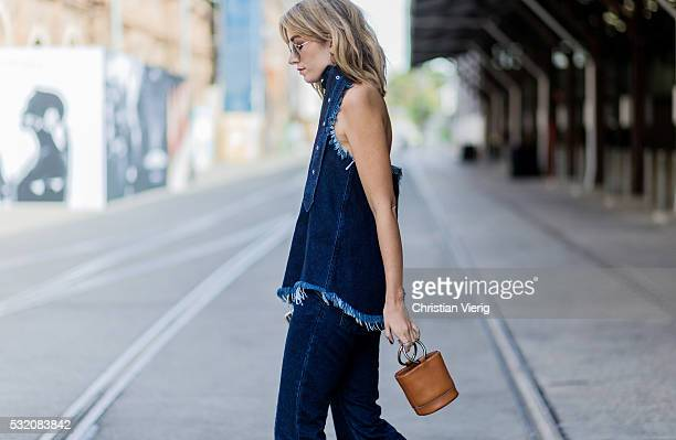 Carmen Hamilton wearing a navy denim jeans and sleeveless denim top from Marques Almeida outside C Meo Collective at MercedesBenz Fashion Week Resort...