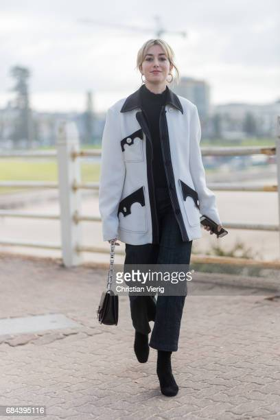 Carmen Hamilton wearing a white coat black pants outside Ten Pieces at day 5 during MercedesBenz Fashion Week Resort 18 Collections at Icebergs on...