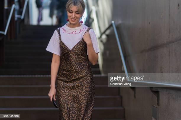 Carmen Hamilton wearing a white tshirt with the print stay wild child and leo print dress at day 3 during MercedesBenz Fashion Week Resort 18...