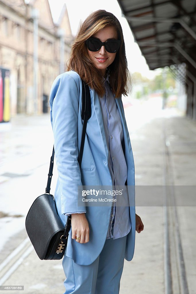 Carmen Hamilton wearing Hansen and Gretel suit, Zara men shirt, Karen Walker sunglasses and Dylan Kain bag at Mercedes-Benz Fashion Week Australia 2014 at Carriageworks on April 10, 2014 in Sydney, Australia.