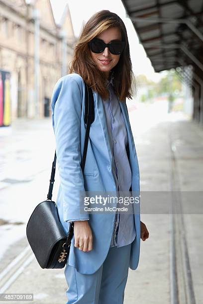 Carmen Hamilton wearing Hansen and Gretel suit Zara men shirt Karen Walker sunglasses and Dylan Kain bag at MercedesBenz Fashion Week Australia 2014...