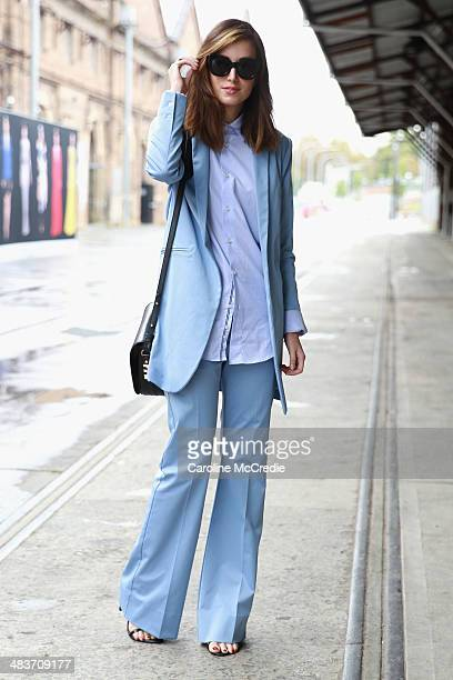 Carmen Hamilton wearing Hansen and Gretel suit Zara men shirt Karen Walker sunglasses and Dylan Kain bag at MercedesBenz Fashion Week Australia 2014...