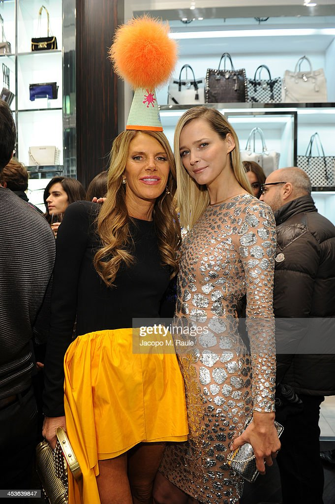 Carmen Kass and Anna dello Russo attend Michael Kors To celebrate Milano opening on December 4, 2013 in Milan, Italy.