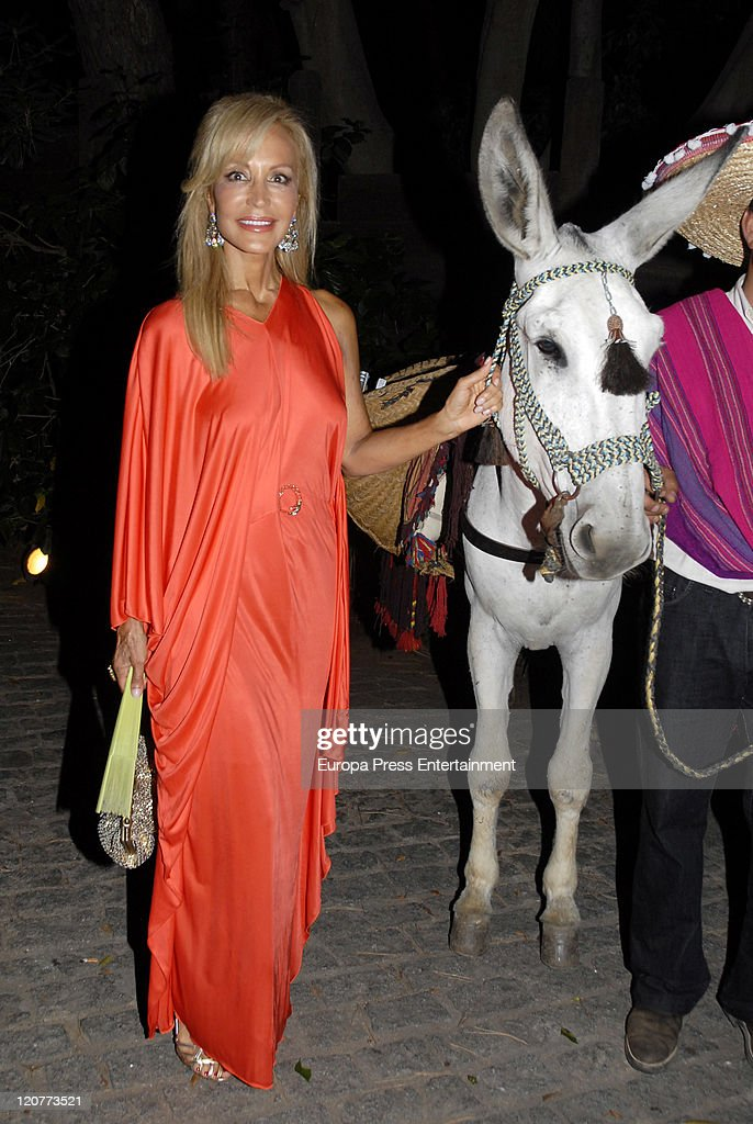 Carmen Lomana is seen with a donkey during a benefit party at the Marbella Club on August 09, 2011 in Marbella, Spain.