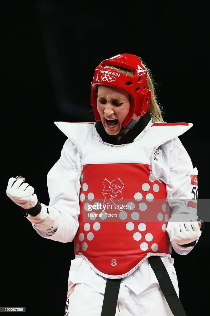 Carmen Marton of Australia celebrates beating Sousan Hajipourgoli of Iran during the Women's 67kg Taekwondo Preliminary Round on Day 14 of the London...