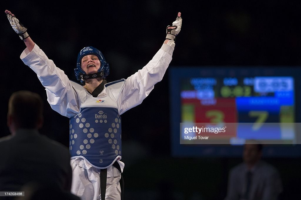 Carmen Marton of Australia celebrates wit her coach after winning the women's -62 kg final combat of WTF World Taekwondo Championships 2013 at the exhibitions Center on July 21, 2013 in Puebla, Mexico.