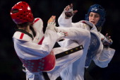 Carmen Marton of Australia competes with HwiLang Kim of Korea women's 62 kg final combat of WTF World Taekwondo Championships 2013 at the exhibitions...