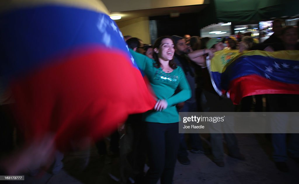 Carmen Mata waves a Venezuelan flag as she and others react to the death of Venezuelan president Hugo Chavez, at El Arepazo 2 a restaurant in the heart of a neighborhood that has the largest concentration of Venezuelans in the U.S. on March 5, 2013 in Doral, Florida. The Venezuelan government announced today that Hugo Chavez lost his battle with cancer.