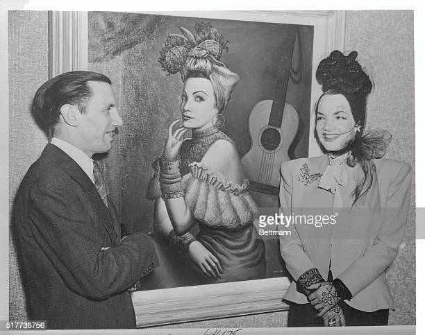 Carmen Miranda and Paul Meltsner with Mr Meltsner's portrait of Miss Miranda The painting had just been presented to the National Museum in Rio de...