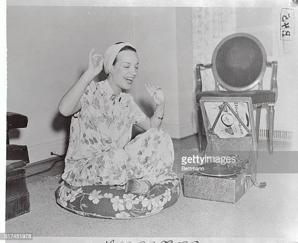 Carmen Miranda is making hey hey at her phonograph after clicking in the grand manner in a current Broadway hit Carmen comes from Brazil and speaks...