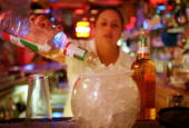 Carmen Molina pours tequila into a huge Margarita September 28 2000 at La Hacienda in El Paso Texas Up to 40 percent of the firms making Mexico's...