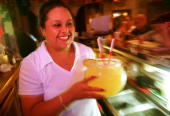 Carmen Molina serves up a huge Margarita September 28 2000 at La Hacienda in El Paso Texas Up to 40 percent of the firms making Mexico's tequila may...