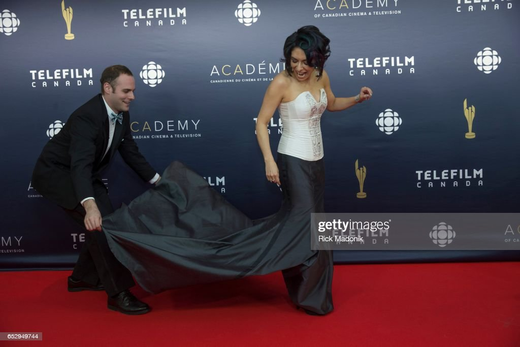 Carmen Moore gets some dress fluffing help as she sets up for photos. Canadian Screen Awards red carpet at Sony Centre for the Performing Arts ahead of the show.