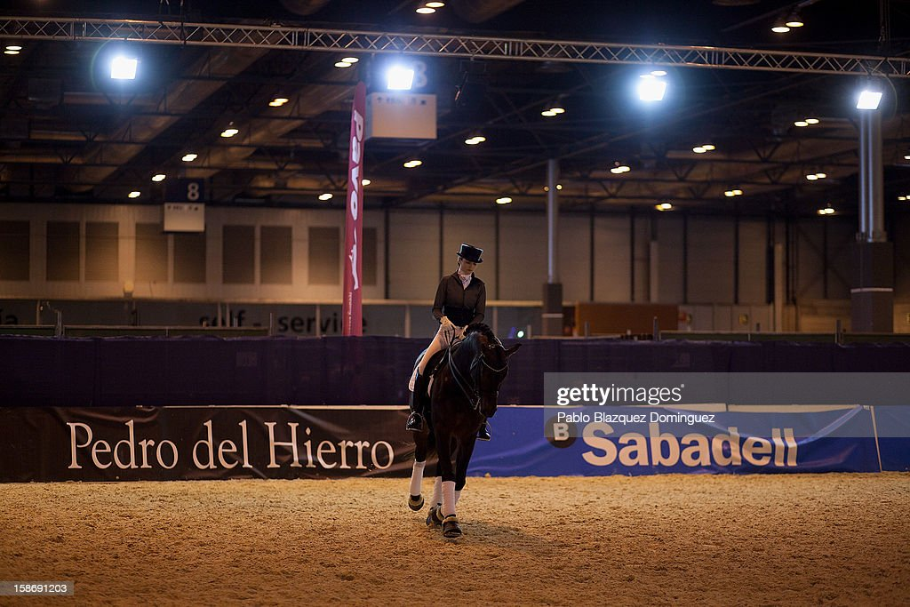 Carmen Naesgaard rides horse Ciowa warming up before performing during Madrid Horse Week Fair at Ifema on December 23, 2012 in Madrid, Spain.