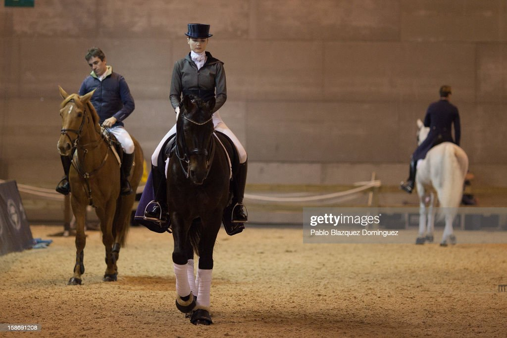 Carmen Naesgaard (C) rides horse Ciowa warming up before performing during Madrid Horse Week Fair at Ifema on December 23, 2012 in Madrid, Spain.
