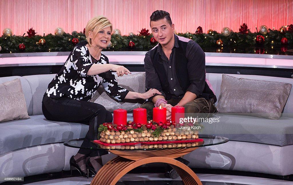Carmen Nebel and Andreas Gabalier attend the TV show 'Die schönsten Weihnachtshits' on December 4, 2014 in Munich, Germany.