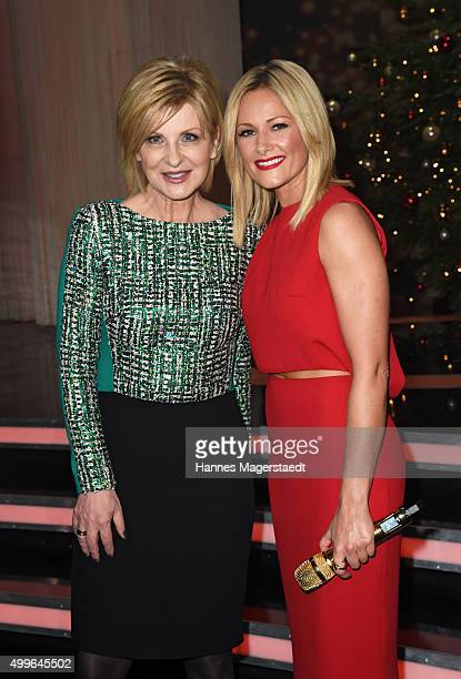 Carmen Nebel and Helene Fischer pose during the 'Die schoensten Weinachtshits' TV Show at Bavaria Filmstudios on December 2 2015 in Munich Germany
