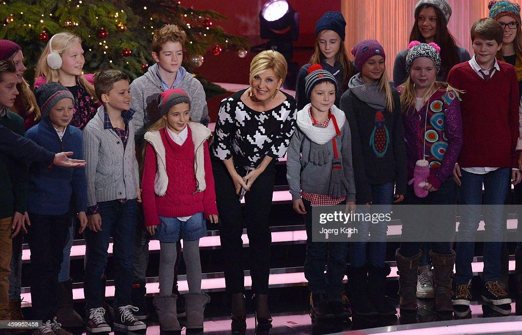 Carmen Nebel and the 'Lucky Kids' attend the TV show 'Die schönsten Weihnachtshits' on December 4, 2014 in Munich, Germany.
