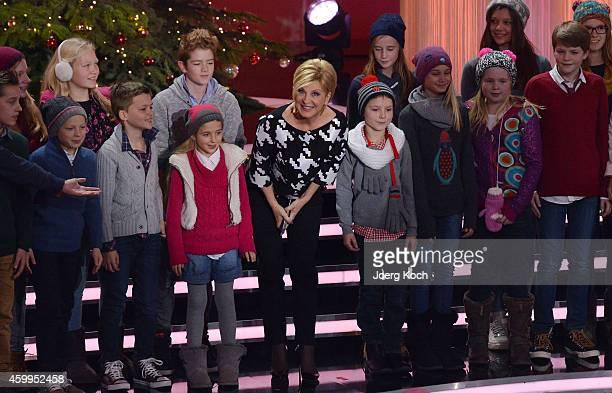 Carmen Nebel and the 'Lucky Kids' attend the TV show 'Die schönsten Weihnachtshits' on December 4 2014 in Munich Germany