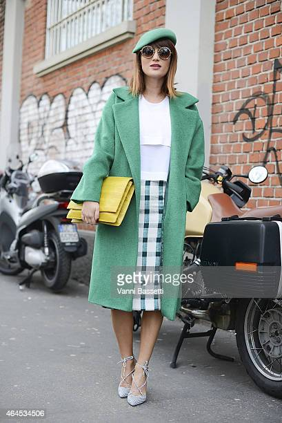 Carmen Negoita poses wearing Urban Post coat Other Stories top Zara skirt Ana Parvan X Carmen Negoita shoes Ralph Laurent hat and Yvy Bags bag on...