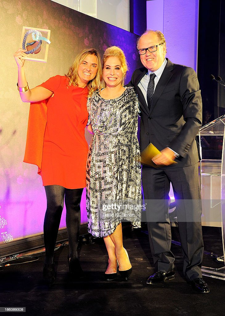 Carmen Silla and Enrique Silla of Jeanologia, winners of the Sustainable Design Team award, and Brix Smith Start (C) pose onstage at The WGSN Global Fashion Awards at the Victoria & Albert Museum on October 30, 2013 in London, England.