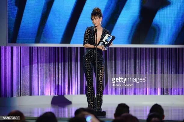 Carmen Villalobos accepts award on stage at Telemundo's 2017 'Premios Tu Mundo' at American Airlines Arena on August 24 2017 in Miami Florida