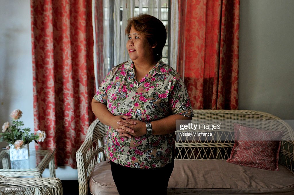 Carmencita Uy, owner of World Class Company Unlimited (WCU), poses for a portrait in her compound on September 10, 2013 in Manila, Philippines. WCU is just one of dozen training centers in Manila that helps overseas contract workers with their skill requirement as they apply for domestic work abroad.