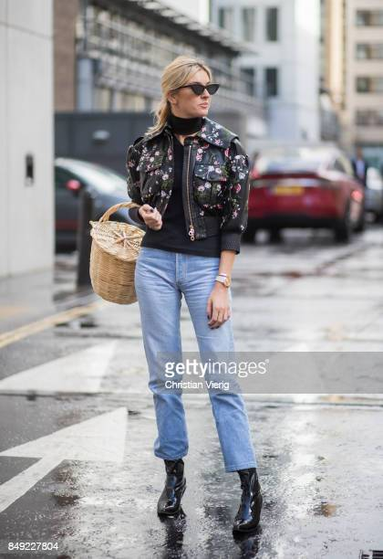 Carmille Charriere wearing straw bag ankle boots denim jeans leather jacket outside Erdem during London Fashion Week September 2017 on September 18...