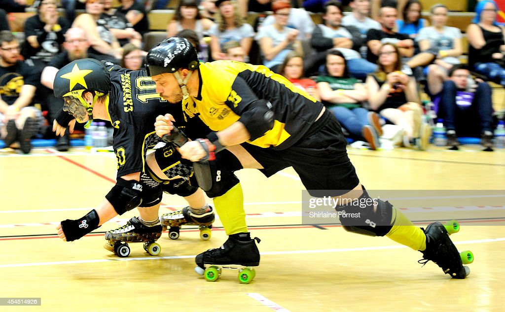 Carnage of Crash Test Brummies and Lucky Bastard of Panam Squad bout in the Men's European Cup roller derby tournament at Walker Activity Dome on August 31, 2014 in Newcastle upon Tyne, England.