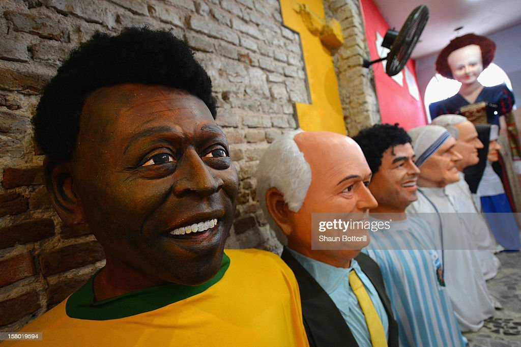 Carnaval masks of Pele, FIFA President Joseph S. Blatter, Diego Maradona and Mother Teresa on December 8, 2012 in Recife, Brazil.