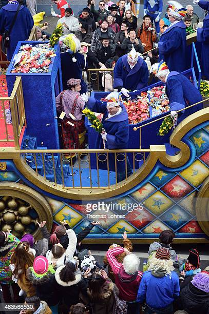 Carneval activists throw sweets from a float in the annual Rose Monday carnival parade on February 16 2015 in Mainz Germany Rose Monday in German...