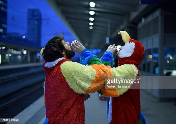 Carneval revellers drink as they celebrate in Essen Central Station on their way to Cologne during Weiberfastnacht celebrations as part of the...