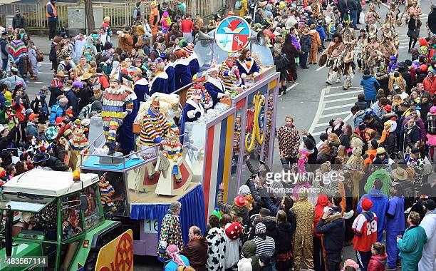 Carnival activists throw sweets from a float in the annual Rose Monday carnival parade on February 16 2015 in Mainz Germany Rose Monday in German...