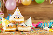 Carnival background with party decoration and cake