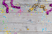 carnival confetti on wood background