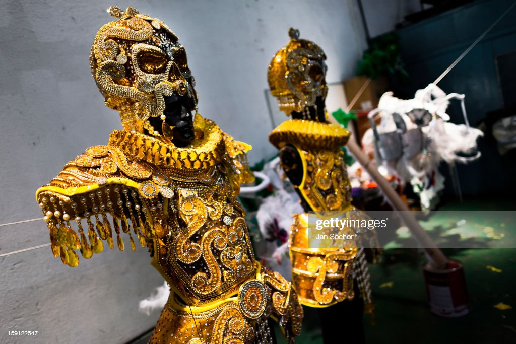 A carnival costume of Acadêmicos da Rocinha samba school (fantasias, in portuguese) seen during the fabrication process inside the workshop in Rio de Janeiro, Brazil, 14 February 2012. The carnival preparations start early in July or August, some 7-8 months before the main samba schools parade at the sambodrome. Samba schools hire teams of professional designers and artists who, according to the original theme selected by the school directors and then featured by the school during the parade, create allegorical floats, costumes, sculptures, music, choreography and the entire school show. However, the most of the everyday work in the carnival hangars is performed by unknown but fully dedicated samba schools members.