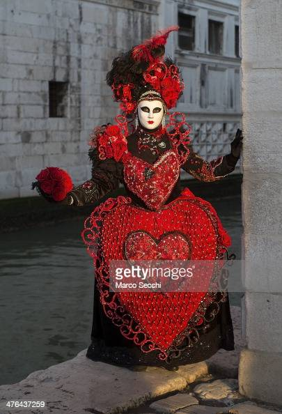 Carnival Costume stands near the bankmof Doge Palace on March 3 2014 in Venice Italy The 2014 Carnival of Venice will run from February 15 to March 4...