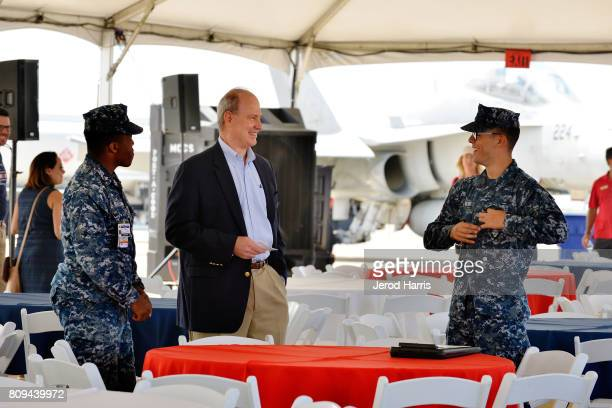 Carnival Cruise Lines Chief Maritime Officer Vice Admiral William Burke speaks with sailors from the United States Navy at Carnival Cruise Line's...