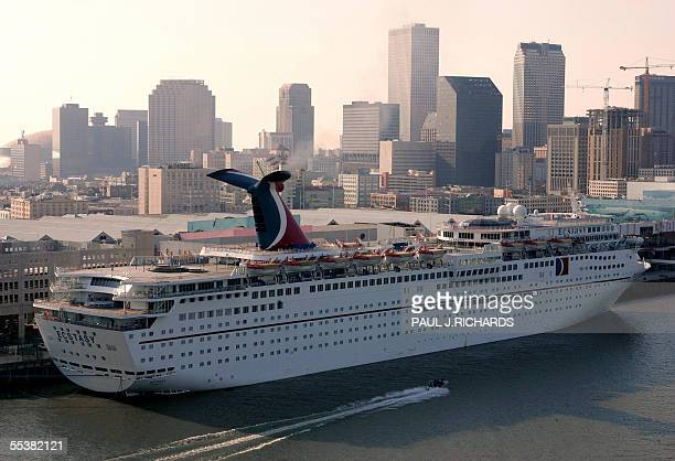 Carnival Cruise Lines' ship Ecstasy docks next to downtown New Orleans late 11 September 2005 in town with sister ship Sensation to house the...