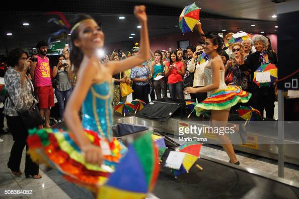 Carnival dancers perform for people arriving in the baggage claim area at Guararapes Gilberto Freyre International Airport on February 4 2016 in...