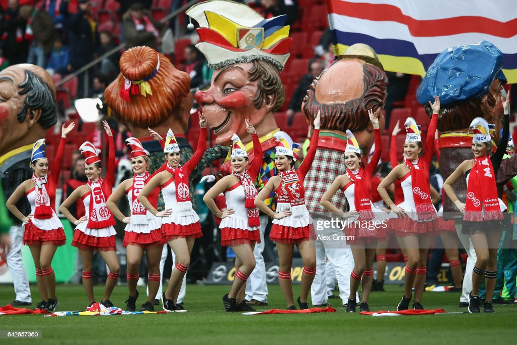 Carnival dancers perform on the pitch prior to the Bundesliga match between 1. FSV Mainz 05 and Werder Bremen at Opel Arena on February 18, 2017 in Mainz, Germany.