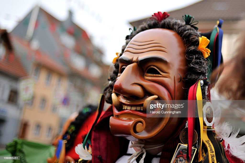 A carnival enthousiast walks in the streets of Elzach prior to the traditional torch parade on January 12, 2013 in Elzach, Germany. The Elzach procession launches the carnival season in southwestern Germany which culminates on Rose Monday. Dating from 1530 the carnival marks a festive period where the bad spirits are expelled prior to the Lenting season.