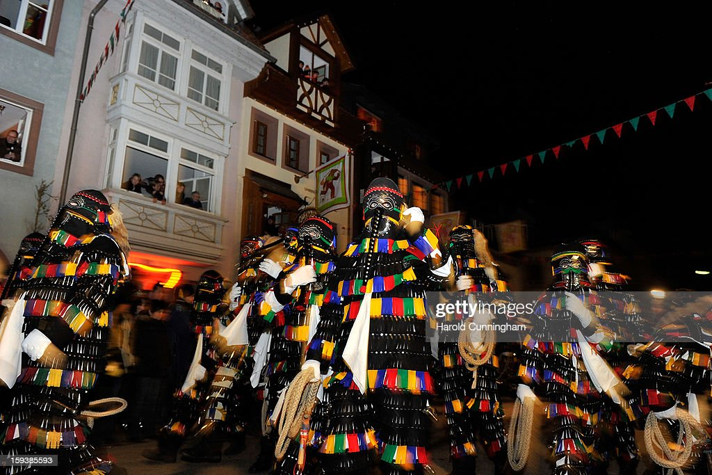 Carnival enthousiasts dance in the streets of Elzach in a costume of the so-called 'Haensele' during the traditional torch parade on January 12, 2013 in Elzach, Germany. The Elzach procession launches the carnival season in southwestern Germany which culminates on Rose Monday. Dating from 1530 the carnival marks a festive period where the bad spirits are expelled prior to the Lenting season.