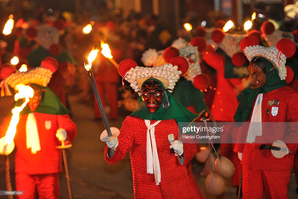 Carnival enthousiasts dance in the streets of Elzach in a costume of the so-called 'Schuttig' during the traditional torch parade on January 12, 2013 in Elzach, Germany. The Elzach procession launches the carnival season in southwestern Germany which culminates on Rose Monday. Dating from 1530 the carnival marks a festive period where the bad spirits are expelled prior to the Lenting season.