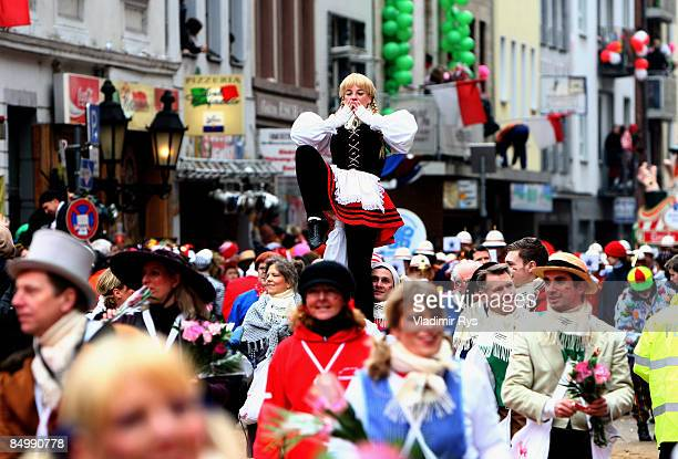 Carnival enthusiasts attend the 'Rose Monday' traditional carnival in Rhine area on February 23 2009 in Cologne Germany